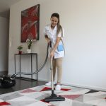 Crown Facility GmbH - Cleaning lady is vacuuming the carpet